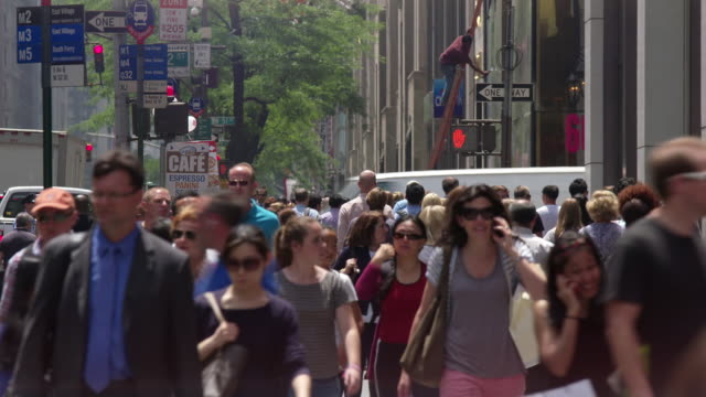 MS View of pedestrians on street day time / New York, United States
