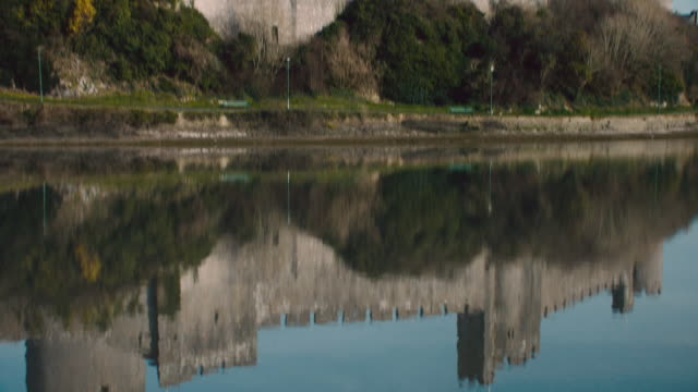 td view of pembroke castle and its reflection in the water / pembroke, wales, united kingdom - pembroke stock videos & royalty-free footage