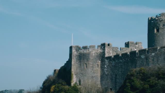 pan a view of pembroke castle / pembroke, wales, united kingdom - pembroke stock videos & royalty-free footage