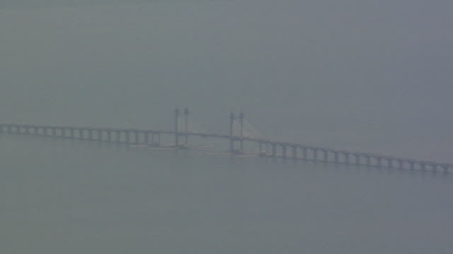 ws view of penang bridge on foggy day seen from penang hills / george town, penang, malaysia - penang bridge stock videos and b-roll footage