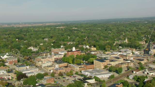 WS AERIAL POV View of Pennsylvania Hotel with townscape area / Woodstock, McHenry County, Illinois, United States