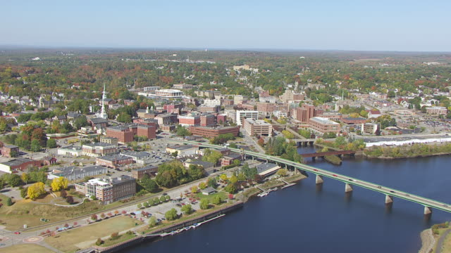 WS AERIAL POV View of Penobscot River with town / Bangor, Maine, United States