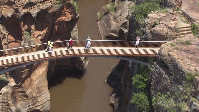 ms aerial ds view of people admiring bourke's luck potholes / polokwane, north west province, south africa - blyde river canyon stock videos and b-roll footage