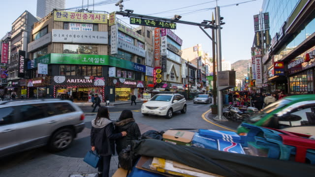 view of people and traffic passing through crossroad of seomyeon (the biggest mainstreet in busan) - busan stock videos & royalty-free footage