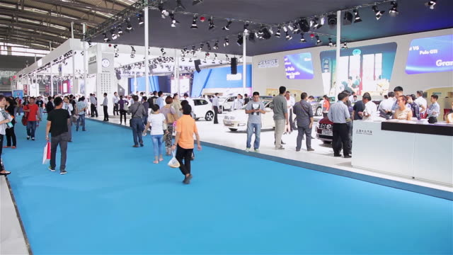 ws view of people at auto show / xi'an, shaanxi, china  - messen stock-videos und b-roll-filmmaterial