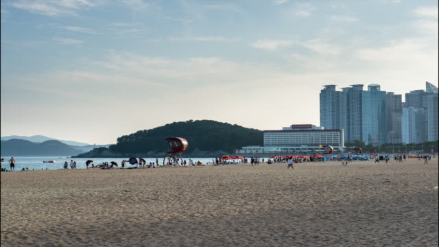 view of people at haeundae beach - lifeguard chair stock videos & royalty-free footage