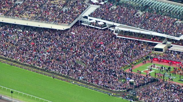 ws aerial zi view of people at melbourne cup horse racing / melbourne, victoria, australia - horse racing stock videos & royalty-free footage