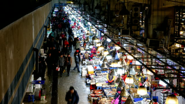view of people at noryangjin fisheries wholesale market (one of korea's largest seafood markets) - fish market stock videos and b-roll footage