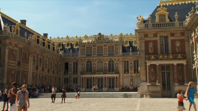 ws view of people at palace exterior / versailles, ile de france, france - palace video stock e b–roll