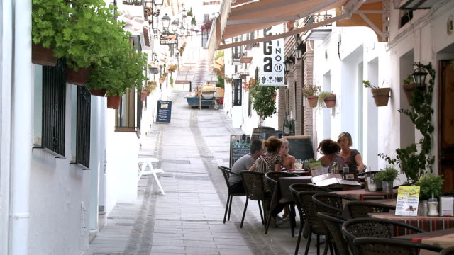 ws view of people at pavement cafe in village mijas / costa del sol, andalusia, spain - pavement cafe stock videos & royalty-free footage