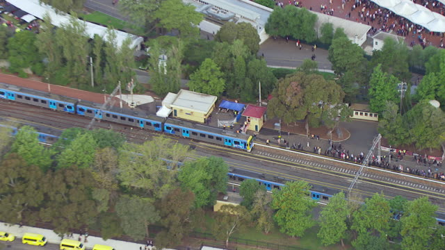 ws aerial zi view of people at railway station / melbourne, victoria, australia - station stock videos & royalty-free footage