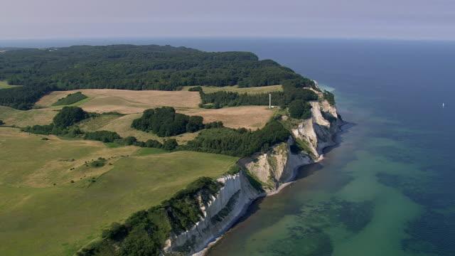 ws aerial zi zo view of people at sea shore / mon, denmark - küste stock-videos und b-roll-filmmaterial
