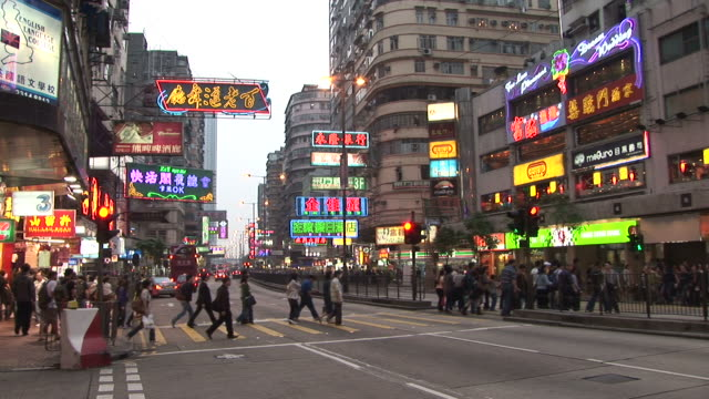 view of people crossing the road in hong kong china - zebramuster stock-videos und b-roll-filmmaterial