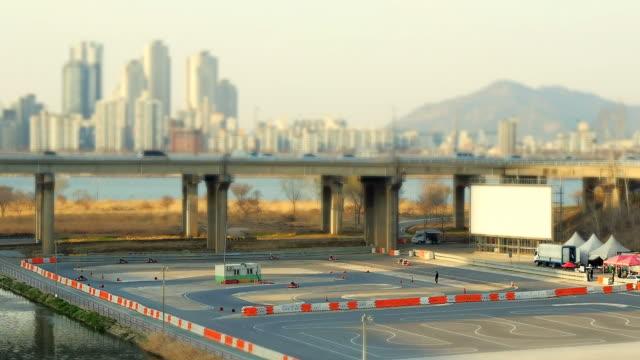WS T/L View of People doing Kart racing around Jamsil Area / Seoul, South Korea