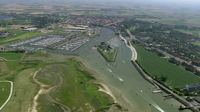 WS AERIAL PAN View of people enjoying at beach near city / Flanders, Belgium
