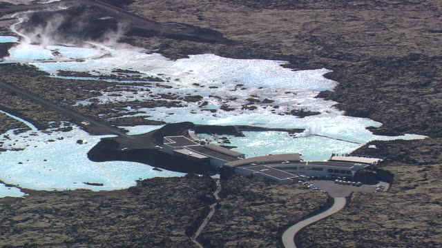 MS AERIAL View of people enjoying at Blue lagoon / Iceland