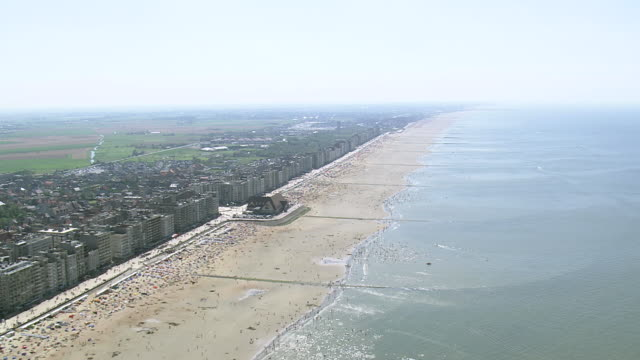 WS AERIAL TD View of people enjoying at Ostende beach / Flanders, Belgium
