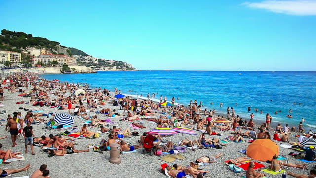WS View of people enjoying French beach / Nice, Provence Alpes Cote d'Azur, France