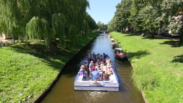 ws ha view of people enjoying their boat ferry from canal, north sea north frisia / friedrichstadt, schleswig holstein, germany - north sea canal stock videos & royalty-free footage