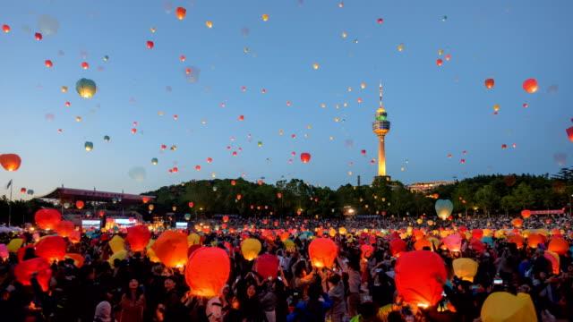 view of people floating their lanterns in daegu lantern festival, south korea - daegu stock videos and b-roll footage
