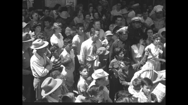 view of people in crowd / tilt down douglas and sterling signing autographs while seated æon the seat of wagon æ/ sterling / sceneæ - kirk douglas actor stock videos & royalty-free footage
