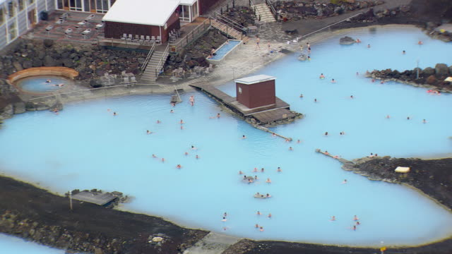 WS AERIAL ZO View of people in Myvatn nature baths at Jardbodin Geothermal / Iceland