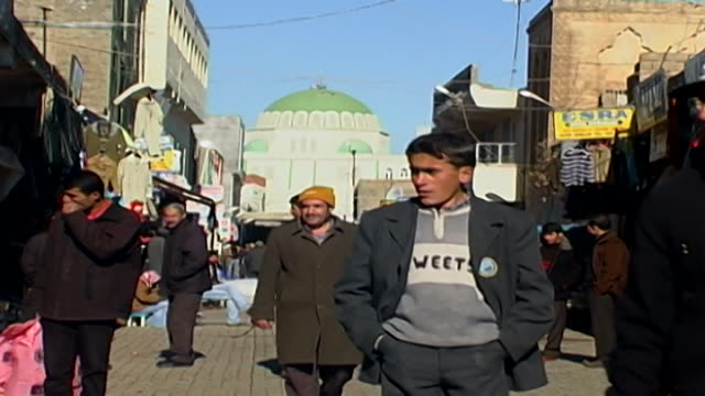 view of people in the market in midyat. - winter stock videos & royalty-free footage