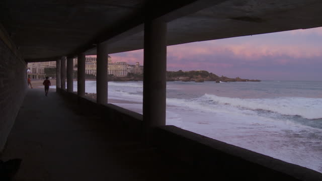 MS View of People jogging in beach and Breaking waves / Biarritz, Pyr̩n̩es Atlantique, France