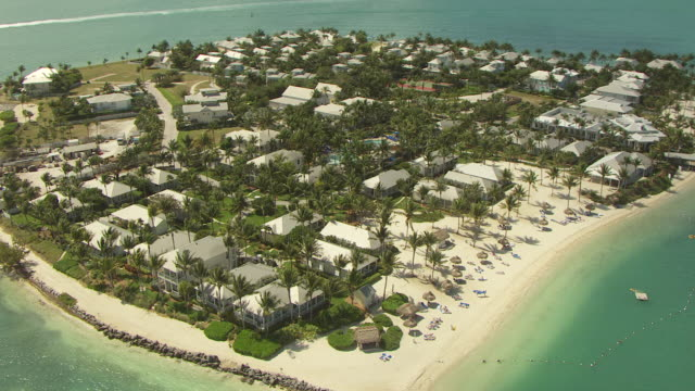 ms aerial zo view of people lying on beach at tank island / key west, florida, united states - key west stock videos & royalty-free footage