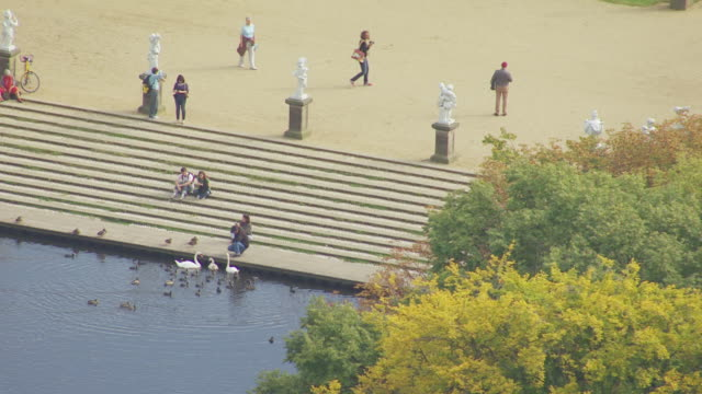 ms aerial view of people near lake at charlottenburg palace / berlin, germany - charlottenburg palace stock videos & royalty-free footage