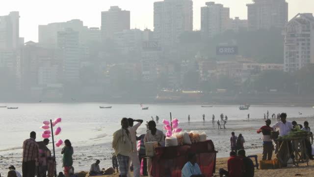 WS T/L View of people on Chowpatty Beach / Mumbai, India