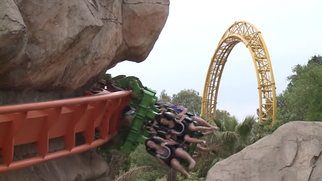 ws view of people on rollercoaster in theme park / johannesburg, gauteng, south africa - ハウテング州点の映像素材/bロール
