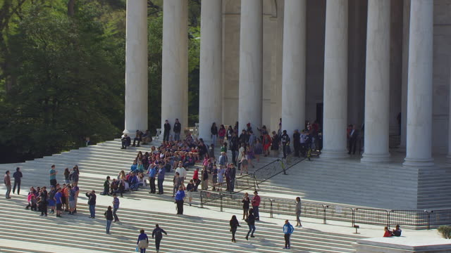 ms zo aerial pov view of people on steps of thomas jefferson memorial and pull out to reveal / tidal basin washington dc, united states  - jefferson memorial stock videos and b-roll footage