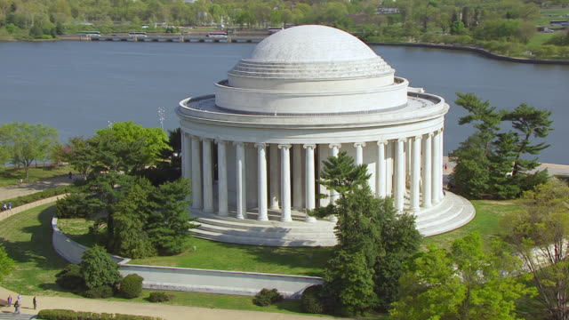 WS TS AERIAL POV View of people on steps of Thomas Jefferson Memorial and pull out to reveal / Tidal Basin Washington DC, United States