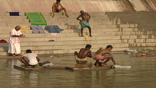 view of people on the steps of meer ghat or embankment. the ghats are used for ritual ablutions and puja ceremonies by the faithful. - embankment stock videos & royalty-free footage