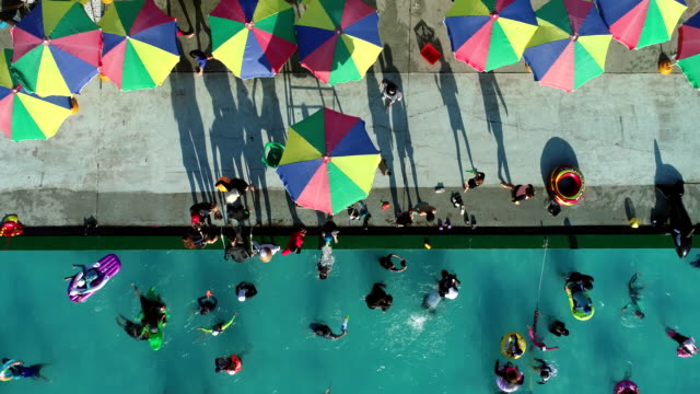 view of people playing at the outdoor swimming pool in ttukseom hangang park, seoul, south korea - parasol stock videos & royalty-free footage