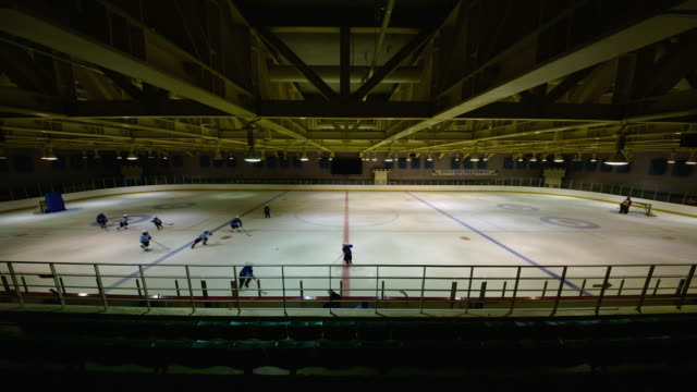 LS T/L View of people playing ice hockey in indoor ice rink / Changwon, Gyeongsangnam-do, South Korea