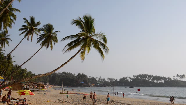 WS View of people playing volley ball on beach / Palolem, Goa, India