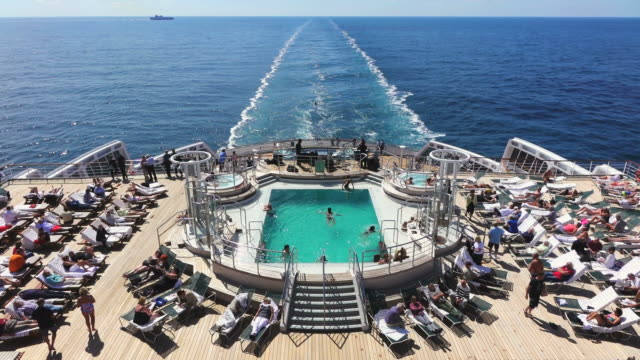 ws pov view of people resting and swimming on cruise ship queen mary 2 / stavanger, rogaland, norway - cruising stock videos & royalty-free footage