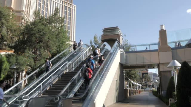 view of people riding escalator near palazzo hotel and casino on the strip, las vegas boulevard, las vegas, nevada, united states of america, north america - the palazzo las vegas stock videos & royalty-free footage
