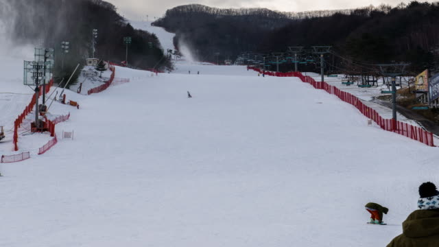 View of people riding snow board and ski on a snowfield at ski resort in Pyeongchanggun (2018 The Olympic Games )