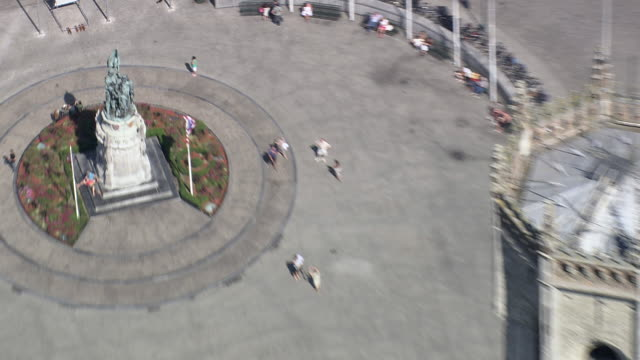 ms aerial pan zo view of people roaming at belfort tower and street cafe at ghent / flanders, belgium - bell tower tower stock videos and b-roll footage