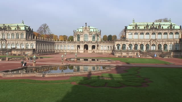 ws view of people roaming at zwinger / dresden, saxony, germany - besichtigung stock-videos und b-roll-filmmaterial