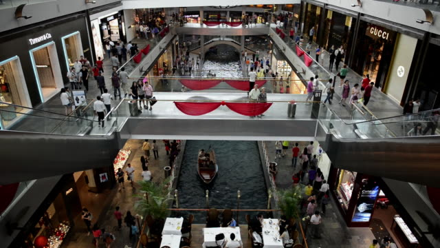 ws ha view of people shopping and roaming in marina bay sands shopping center / singapore - shopping mall stock videos & royalty-free footage