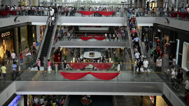 ws view of people shopping and roaming in marina bay sands shopping center / singapore - shopping mall stock videos & royalty-free footage