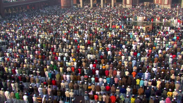 View of people standing for pray in Jama Masjid mosque