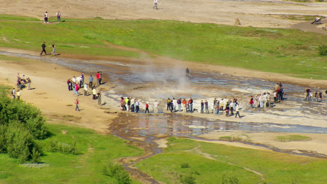 WS ZO AERIAL View of People standing near Strokkur Geyser / Iceland