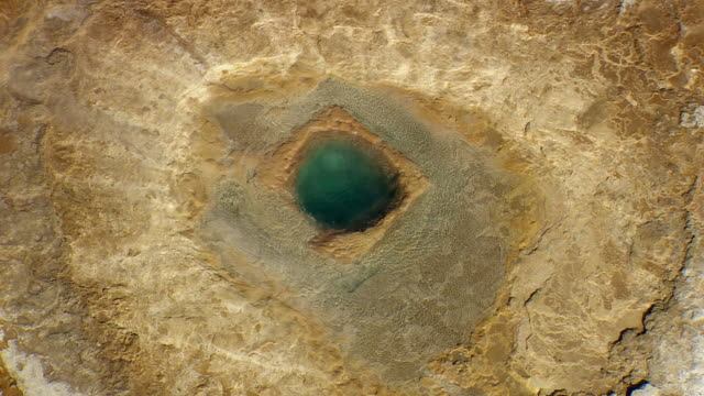 ws zo aerial view of people standing near strokkur geyser / iceland - geyser stock videos & royalty-free footage