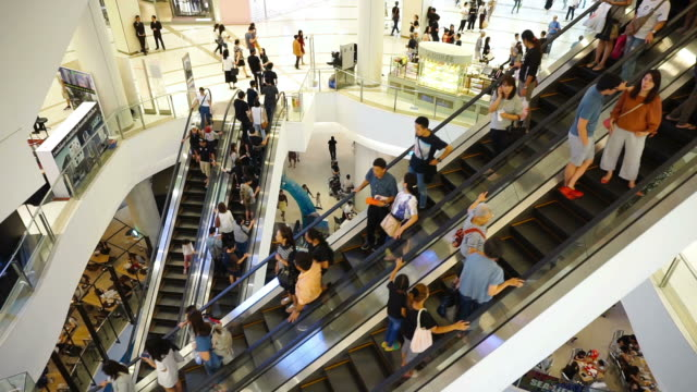view of people taking white escalators in shopping mall in bangkok - escalator stock videos & royalty-free footage