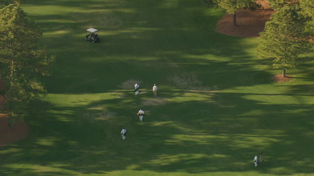 MS AERIAL View of people walking at Augusta national golf course / Georgia, United States